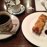 Photo taken at 珈琲散歩 by Tomomi N. on 4/9/2013