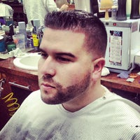 Photo taken at Carl's Barber Shop by Carlos G. on 3/9/2013