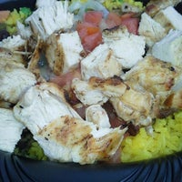 Photo taken at Pollo Tropical by Maggie H. on 10/27/2012