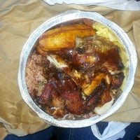 Photo taken at Golden Krust Caribbean Bakery and Grill by Promotress A. on 5/1/2013