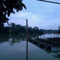 Photo taken at Situ Sawangan by Riiand W. on 1/24/2013