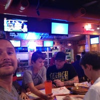 Photo taken at Hooters by Jason D. on 10/21/2013