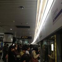 Photo taken at Shanghai Indoor Stadium Metro Stn. by motoki k. on 4/10/2013