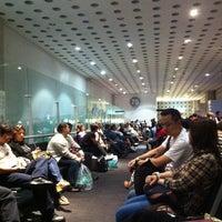 Photo taken at Sala/Gate 75 by Lizbeth A. on 10/14/2012