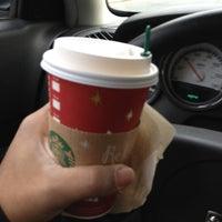 Photo taken at Starbucks by Javier R. on 11/30/2012