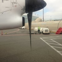 Photo taken at Gate 95 by Marc L. on 10/9/2012