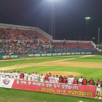 Photo taken at Mudeung Baseball Stadium by Sun K. on 10/6/2012
