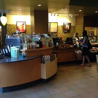 Photo taken at Starbucks by Eve on 7/24/2014