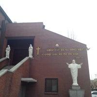 Photo taken at Jungang-dong Catholic Church by Seungyeon H. on 1/1/2014