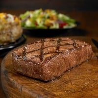 Photo taken at Outback Steakhouse by OSI Restaurant Partners, LLC M. on 5/29/2015