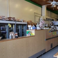Photo taken at Russell Street Deli by Q T. on 2/24/2015