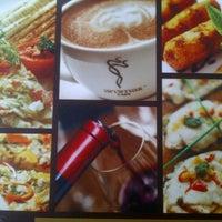 Photo taken at Aromas Café by Ankeet D. on 10/29/2012