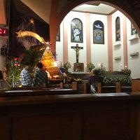 Photo taken at Gereja Katolik Kristus Raja by Katarina R. on 12/24/2012