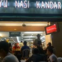 Photo taken at Original Kayu Nasi Kandar Restaurant by Firdaus Y. on 9/15/2012