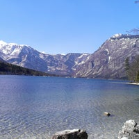 Photo taken at Bohinjsko jezero (Bohinj Lake) by Сергей К. on 3/17/2014
