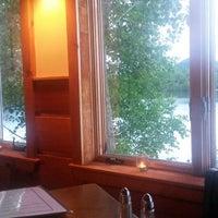 Photo taken at Brown Dog Café & Wine Bar by Fernando B. on 6/18/2014