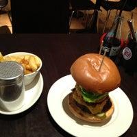 Photo taken at Gourmet Burger Kitchen by Jiri K. on 1/15/2012