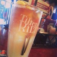 Photo taken at Tilted Kilt Pub & Eatery by Jonathan D. on 5/19/2013