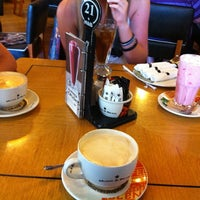 Photo taken at Mugg & Bean Garden Route Mall by Jacques O. on 12/17/2012