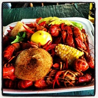 Photo taken at Cajun Cafe On The Bayou by Michael on 5/10/2013