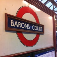Photo taken at Barons Court London Underground Station by Redha A. on 5/25/2013