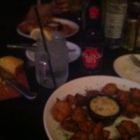 Photo taken at Moe Joe's Cajun & Caribbean Cuisine by Christina on 7/25/2013