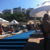 Photo taken at Mio Bianco Beach Club by Sevnur on 7/25/2013