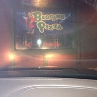 Photo taken at Beggars Pizza by Phylis R. on 12/4/2012
