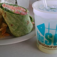 Photo taken at The Surf Restaurant & Bar by Robert R. on 7/18/2013