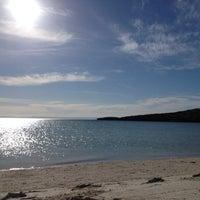 Photo taken at Playa Pichilingue by Karina M. on 3/13/2012