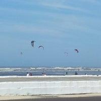 Photo taken at Praia de Imbé by Poli L. on 9/7/2013