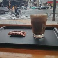 Photo taken at Starbucks Coffee 神田駅前店 by Kazuki S. on 10/25/2013