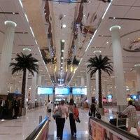 Photo taken at Dubai International Airport (DXB) by bonyarinko on 6/17/2013
