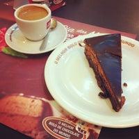Photo taken at O Melhor Bolo de Chocolate do Mundo by Amyntor B. on 5/19/2013
