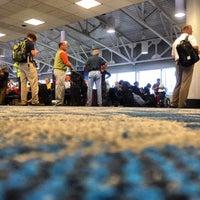 Photo taken at Gate C19 by John P. on 10/8/2012