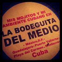 Photo taken at La Bodeguita del Medio by Adriana on 3/6/2013
