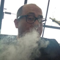 Photo taken at Smokeless Smoking Vapor Lounge by Chris on 2/10/2013