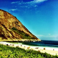 Photo taken at Praia de Itacoatiara by Rodrigo A. on 12/13/2012