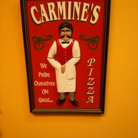 Photo taken at Carmine's Pizzeria by Burton C. on 12/14/2012