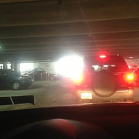 Photo taken at Perry Street Parking Garage by Casey K. on 1/25/2013