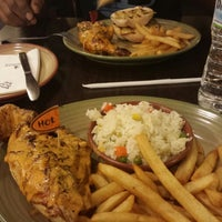 Photo taken at Nando's by Sunshine R. on 1/4/2014
