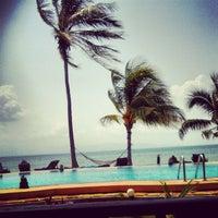 Photo taken at First Villa Resort  Pha-ngan by Екатерина Л. on 1/24/2013