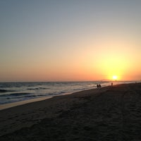 Photo taken at Huntington State Beach by Moses on 5/18/2013