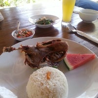 Photo taken at Bebek Bengil (Dirty Duck Diner) by Jane T. on 10/22/2013