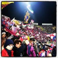 Photo taken at Stadio Renato Dall'Ara by Alessandro D. on 3/16/2013