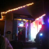 Photo taken at SOS Daiquiri Bar & Grill by Lacie S. on 12/8/2012