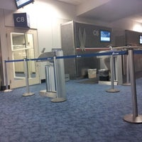 Photo taken at Gate C8 by Cary C. on 10/15/2012