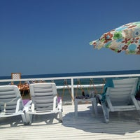Photo taken at Solar Beach by Mert on 7/28/2013