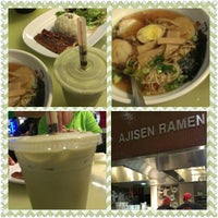 Photo taken at Ajisen Ramen by Kevin C. on 12/25/2012