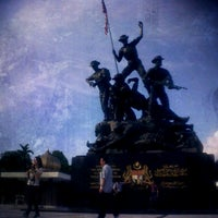 Photo taken at National Monument (Tugu Negara) by Adlail Z. on 1/6/2013